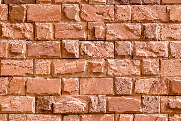 Parede de pedra áspera para textura ou plano de fundo.