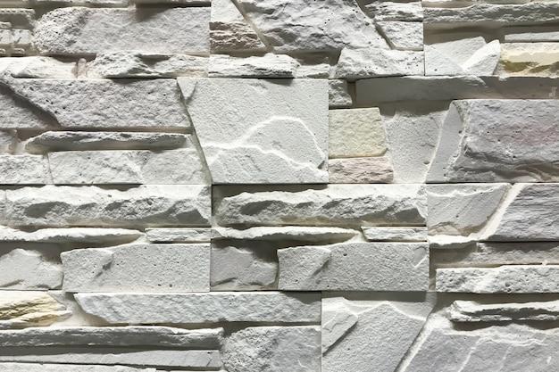 Parede de pedra com design de artesanato interior de pedras de retângulo