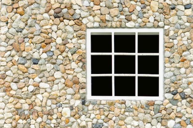 Parede de pedra com fundo branco da janela
