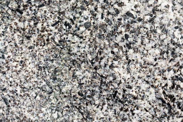 Parede de pedra com fundo cinza com cor bege