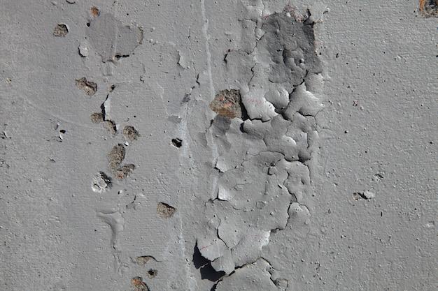 Parede de pedra com tinta velha e rachada. foto de alta qualidade