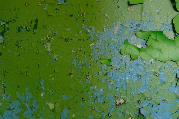 Parede de pedra com tinta verde velha. plano de fundo para o design. foto de alta qualidade