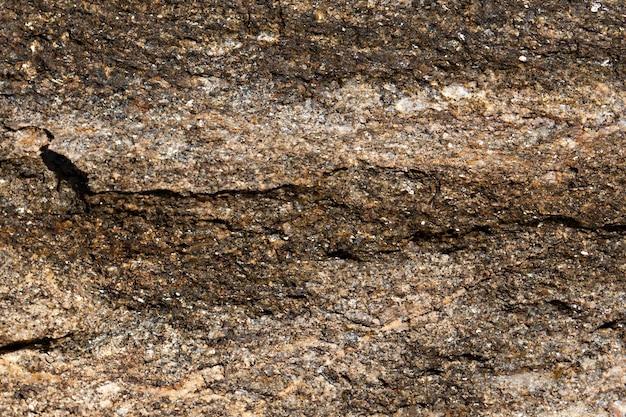 Parede de pedra de textura marrom de fundo