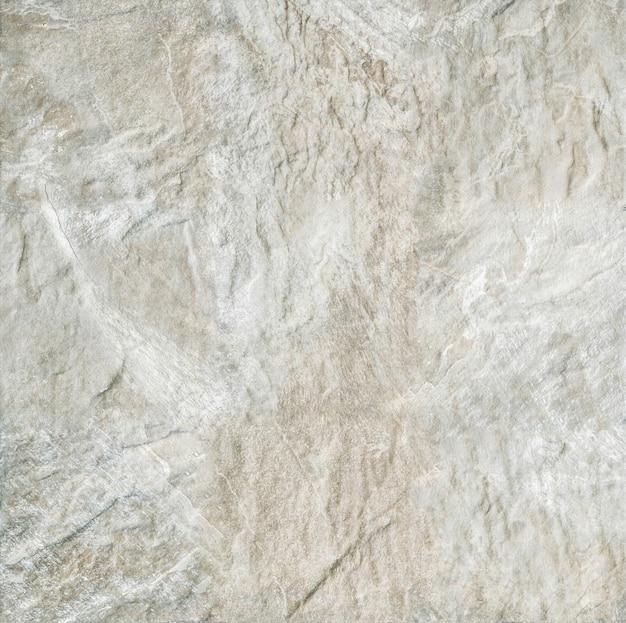 Parede de pedra marrom abstrata da superfície do close up no fundo da textura da parede da casa