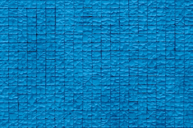 Parede de pedra . parede de pedra envelhecida da areia para o fundo da textura e do projeto. cor azul na moda do ano.