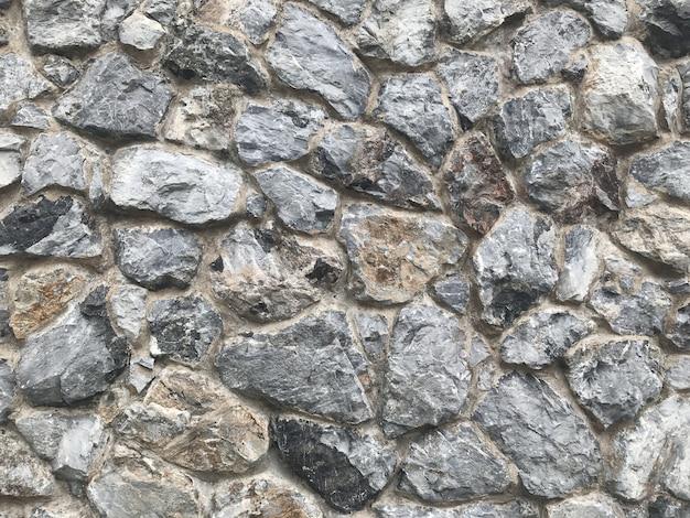 Parede de pedra resistida envelhecida