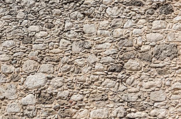 Parede de pedra velha com janela