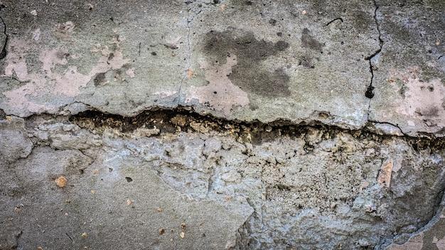 Parede de pedra velha com uma rachadura. textura para design