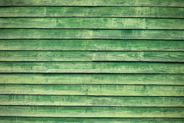 Parede de tábuas de madeira verdes, textura de tábuas vintage, plano geral