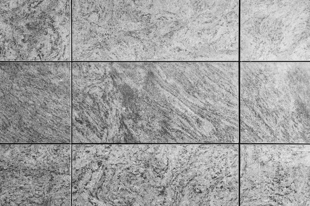 Parede de telha de textura de granito cinza natural, mármore travertino cinza, fundo de superfície de rocha. grunge