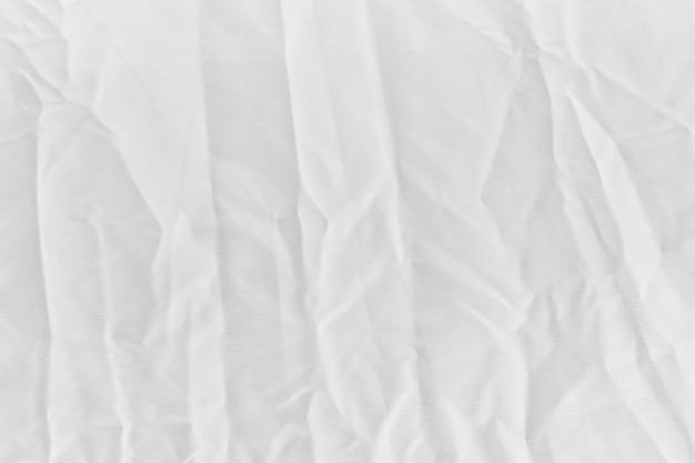 Parede de textura de lona de tecido de algodão branco enrugado close-up para o pano de fundo do projeto ou parede de sobreposição