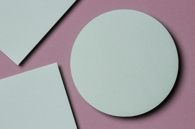 Parede de textura de papel colorido abstrato. formas e linhas geométricas em tons pastéis de verde e bege