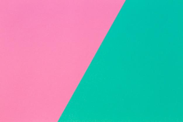 Parede de textura de papel de cor rosa claro e turquesa. parede de papel geométrico abstrato com cores da moda