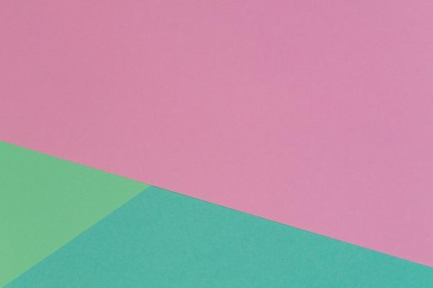 Parede de textura de papel de cor rosa pastel e verde claro. parede de papel geométrico abstrato com cores da moda