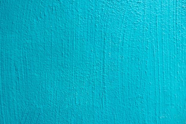 Parede de textura de parede de estuque pintado de ciano azul claro grunge abstrato com espaço de cópia