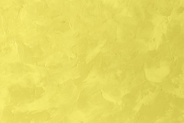 Parede de textura grunge para segundo plano. cor da moda do ano 2021 - amarelo brilhante