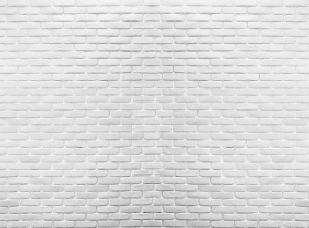 Parede de tijolo branca na arquitetura da decoração para o fundo do projeto.