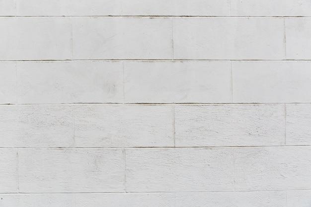 Parede de tijolo branco com aparência grossa