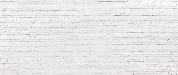 Parede de tijolo branco do grunge, fundo caiado de alvenaria
