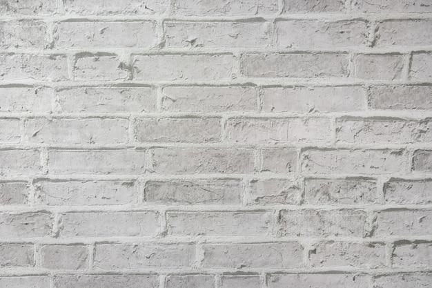 Parede de tijolo branco uma textura resistida para o fundo