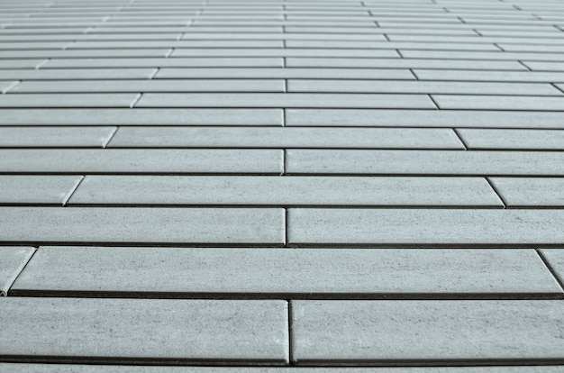 Parede de tijolo cinza em perspectiva