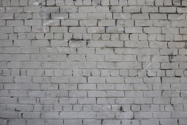 Parede de tijolo cinza textura resistida manchada pintura velha parede de tijolo cinza fundo colorido da parede de tijolo