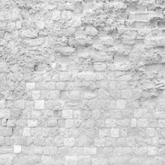 Parede de tijolo de deterioração cinza