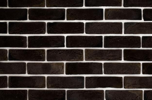 Parede de tijolo marrom escuro, fundo criativo, close-up