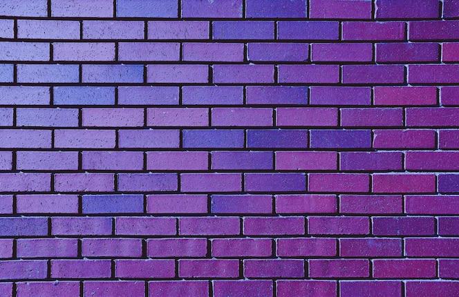 Parede de tijolo roxo bonito para o fundo