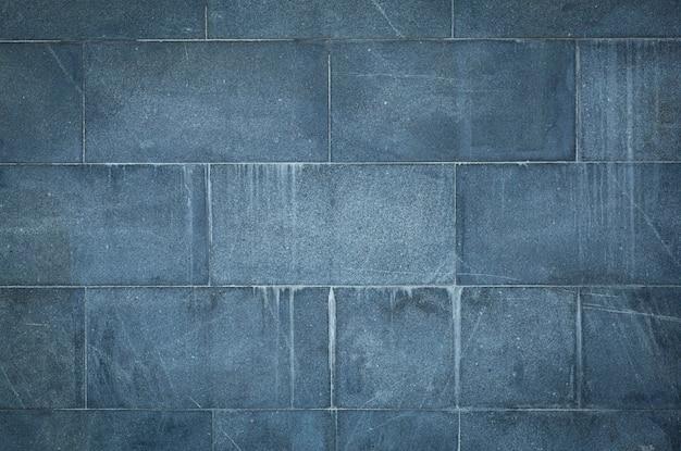 Parede de tijolo velha. alvenaria de uma velha pedra de marable em estilo rústico. a estrutura e o padrão da parede de pedra destruída. copie o espaço.
