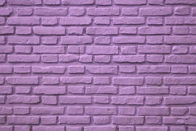 Parede de tijolo velha colorida roxa para o fundo