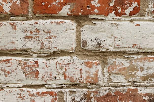 Parede de tijolo velha com pintura azul rachada