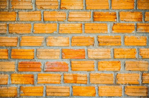 Parede de tijolo vermelho do vintage a parede de tijolo velha, textura velha da pedra vermelha obstrui o close up.