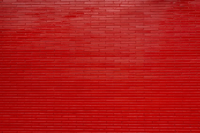 Parede de tijolo vermelho e acabamento de rejunte