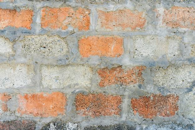 Parede de tijolo vermelho e cinza. textura abstrata do fundo. estoque de fotos