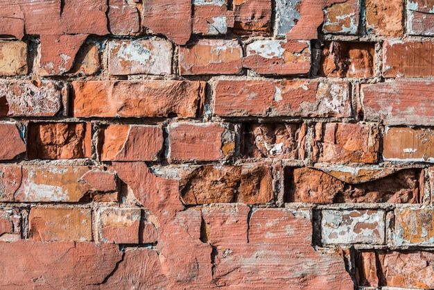 Parede de tijolo vermelho velha, fundo horizontal do grunge.