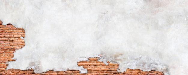 Parede de tijolo vintage, superfície com gesso em ruínas.