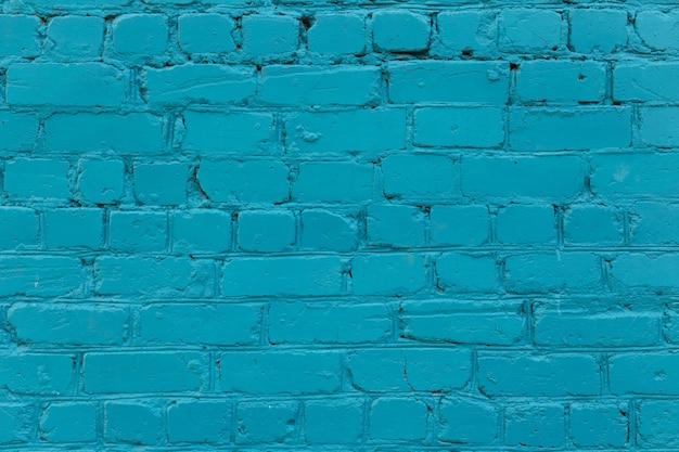 Parede de tijolos. a parede de tijolos pintada de azul Foto Premium