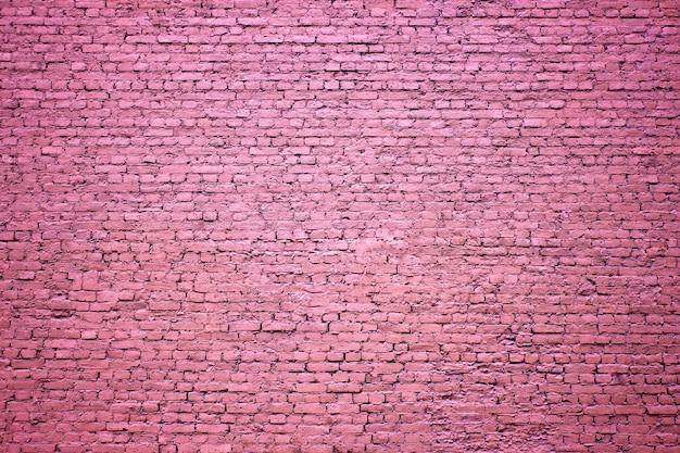 Parede de tijolos, a superfície dos blocos, fundo roxo