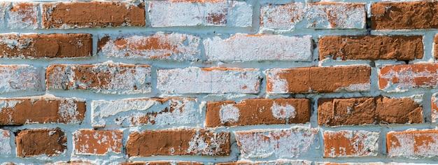 Parede de tijolos antigos com tijolos vermelhos e brancos