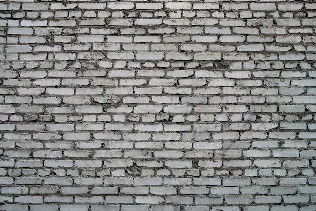 Parede de tijolos antigos e realistas de tijolo branco
