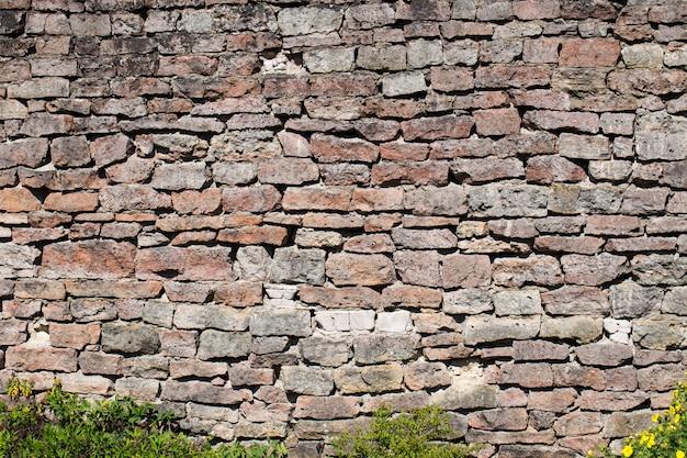 Parede de tijolos antigos (pedra, fundo, textura)