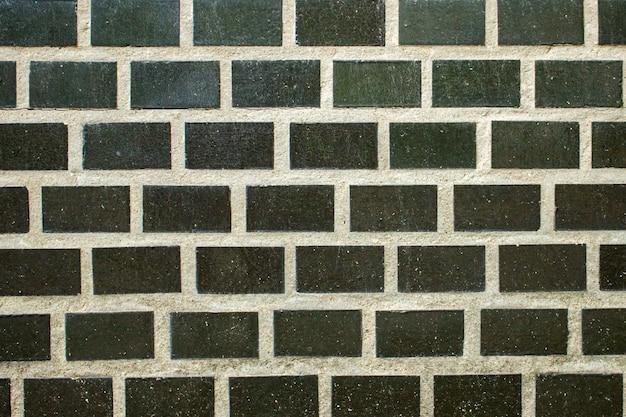 Parede de tijolos antigos. textura grunge. papel de parede preto. superfície escura