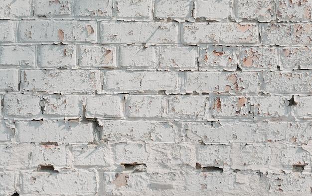 Parede de tijolos brancos. casa velha. fundo rústico