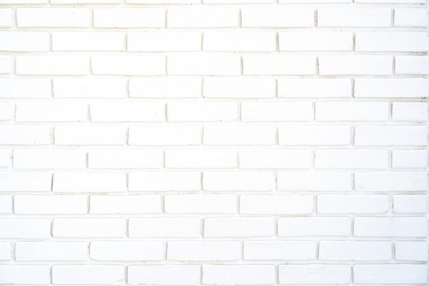Parede de tijolos brancos com fundo de linhas de concreto