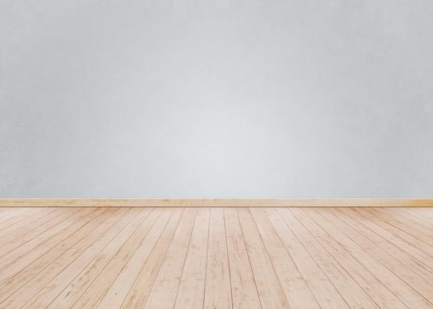 Parede de tijolos brancos com piso de madeira