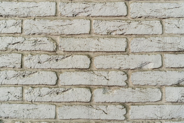 Parede de tijolos brancos. textura de tijolo com recheio branco