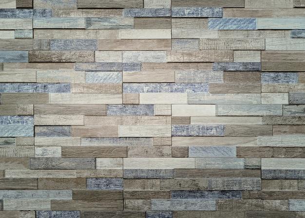 Parede de tijolos de cimento com tons de bege e azul