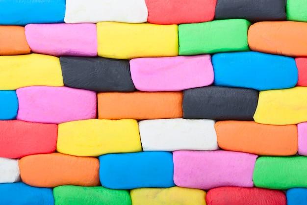 Parede de tijolos de plasticina colorida closeup extrema