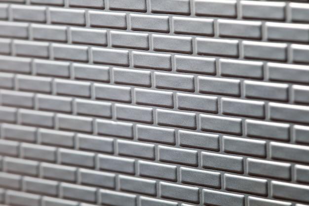 Parede de tijolos metálicos fundo
